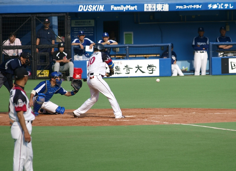 Ohmatsu swings at the game-winning pitch