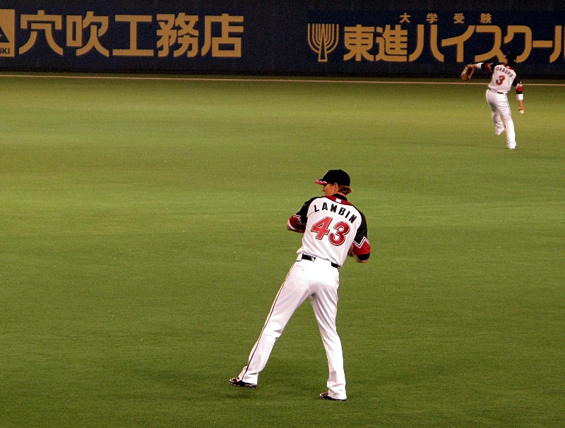 Lambin and Saburo prepare to watch balls fly over their heads
