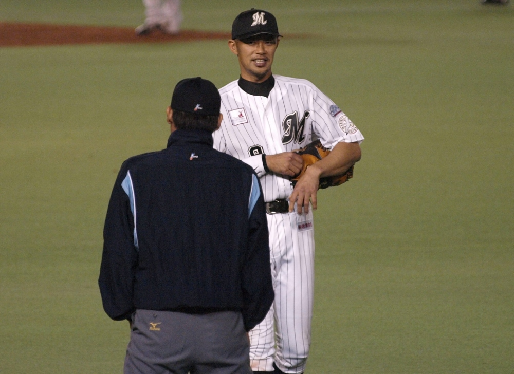 Fukuura shares a joke with the ump