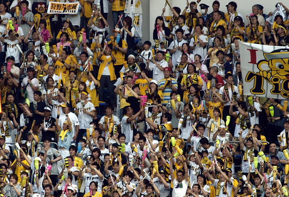 Hanshin fans using noisemakers, of course