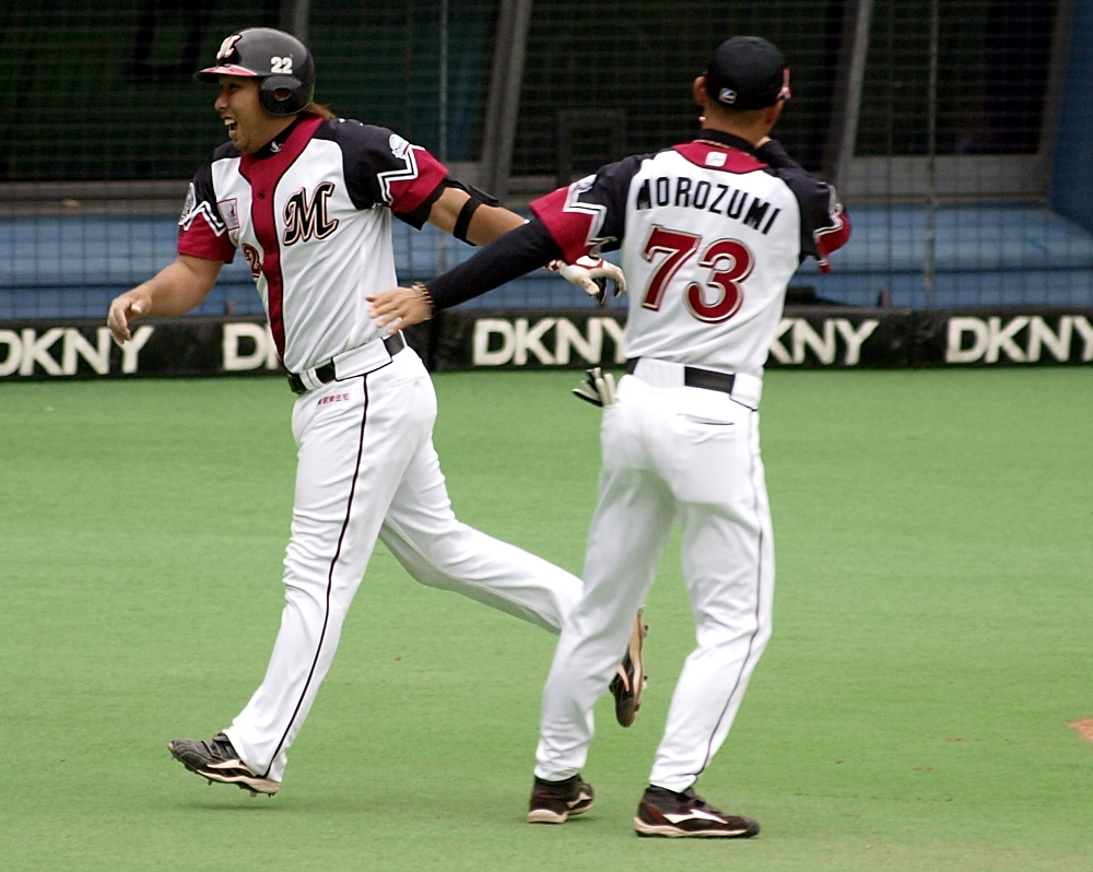 Morozumi gives Sato a pat for his homer to right
