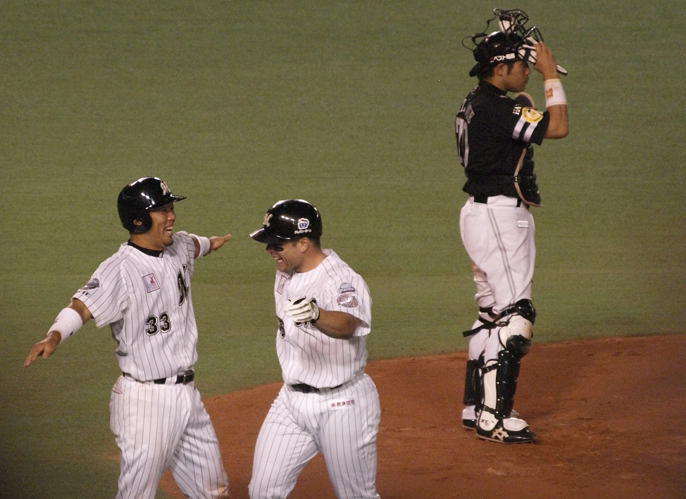 Hashimoto and Burnham Jr celebrate at the plate