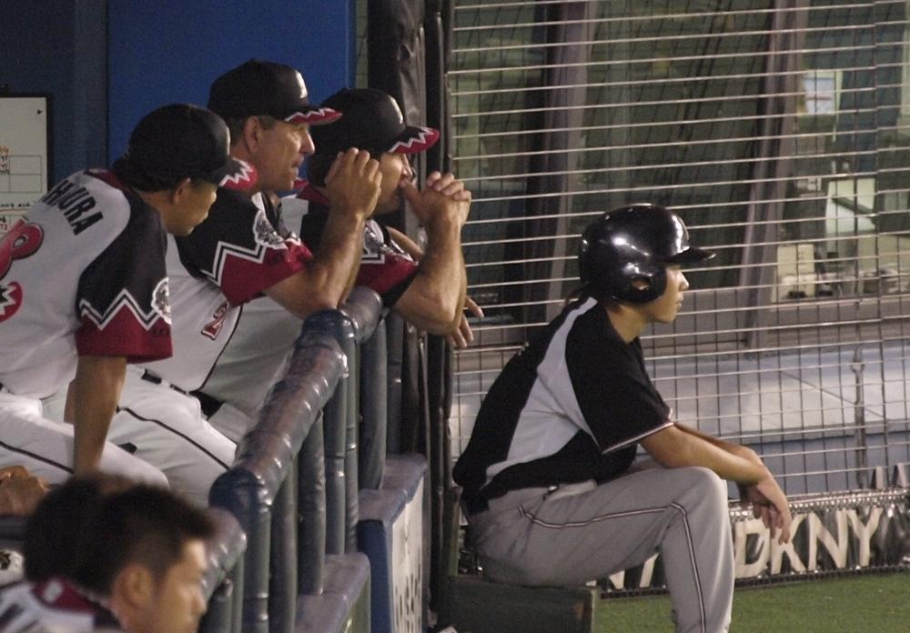 Bobby, Frank, and Nishimura watch Watanabe in anticipation