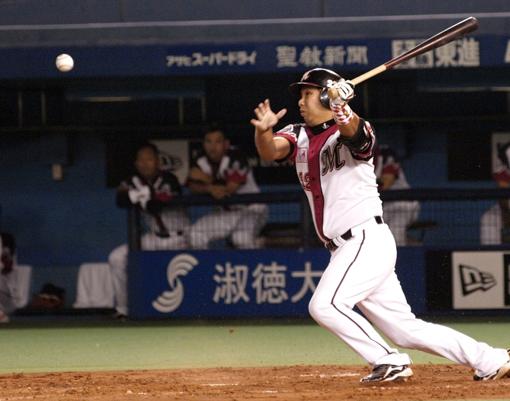 Possibly the only pic I have of Sato with a bat still in his hands