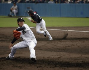 Ogino makes his pitch as the runner makes his break